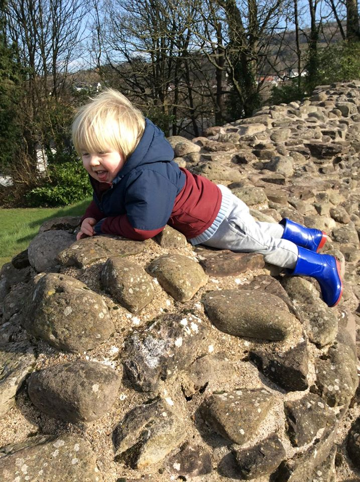 Mr X climbing a castle wall